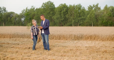 Agriculture-Farmer-Talking-With-Businessman-At-Harvesting-1