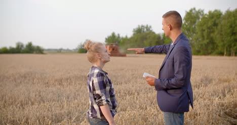 Agriculture-Female-And-Male-Farmers-Talking-At-Wheat-Field-During-Harvesting-12
