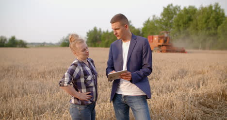 Agriculture-Female-And-Male-Farmers-Talking-At-Wheat-Field-During-Harvesting-13