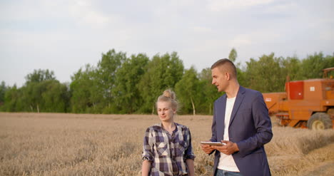 Young-Farmers-Discussing-At-Wheat-Field-28
