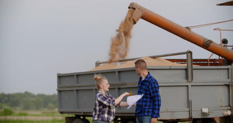 Agriculture-Female-And-Male-Farmers-Talking-At-Wheat-Field-During-Harvesting-14