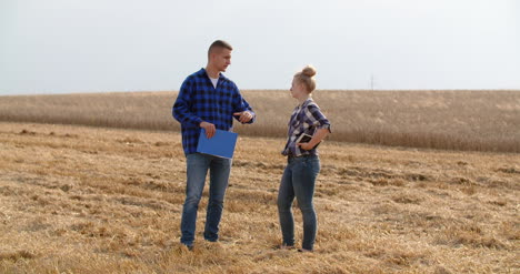 Young-Farmers-Discussing-At-Wheat-Field-30