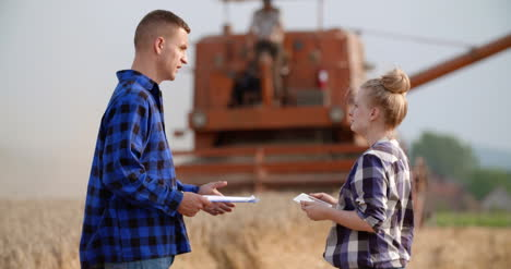 Young-Farmers-Discussing-At-Wheat-Field-31