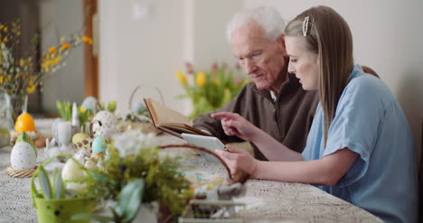 Young-Woman-Surfing-Internet-With-Grandfather-On-Digital-Tablet-6