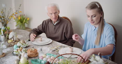 Happy-Easter-Grandfather-And-Granddaughter-Spending-Easter-Together-At-Home-