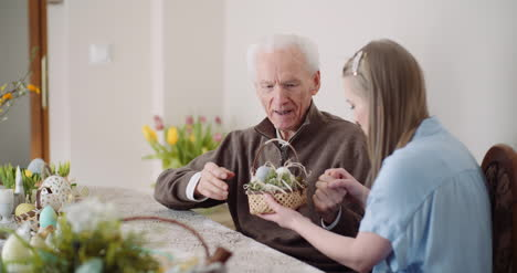 Happy-Easter-Young-Woman-Give-Easter-Gift-To-Grandfather
