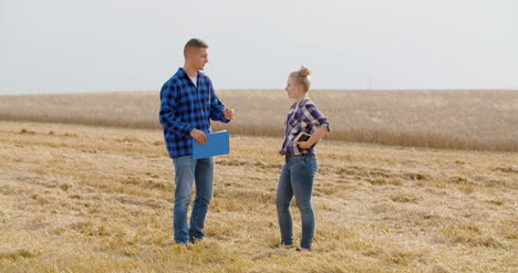 Young-Farmers-Discussing-At-Wheat-Field-33