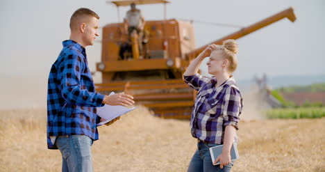 Young-Farmers-Discussing-At-Wheat-Field-2