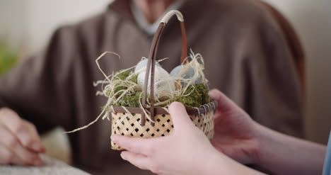 Happy-Easter-Young-Woman-Give-Easter-Gift-To-Grandfather-3