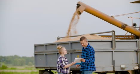 Young-Farmers-Discussing-At-Wheat-Field-3