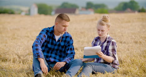 Agriculture-Female-And-Male-Farmers-Talking-At-Wheat-Field-During-Harvesting-15
