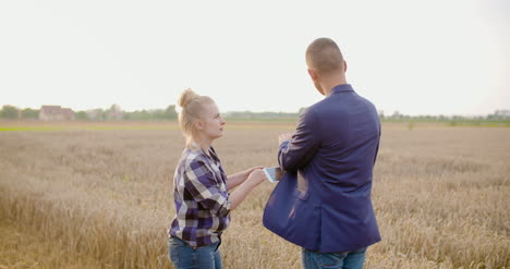 Young-Farmers-Discussing-At-Wheat-Field-4