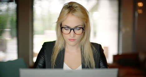 Young-Woman-Working-Until-Late-Evening-In-Office