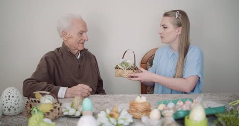 Happy-Easter-Young-Woman-Give-Easter-Gift-To-Grandfather-4