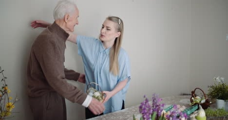 Happy-Easter-Young-Woman-Give-Easter-Gift-To-Grandfather-5