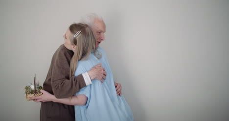 Happy-Easter-Young-Woman-Give-Easter-Gift-To-Grandfather-6