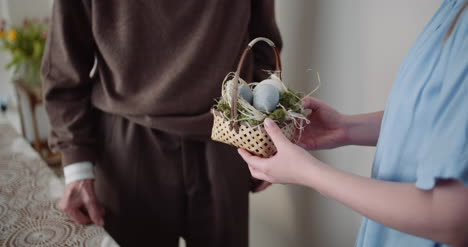 Happy-Easter-Young-Woman-Give-Easter-Gift-To-Grandfather-7