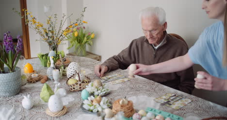 Happy-Easter-Young-Woman-Give-Easter-Gift-To-Grandfather-8
