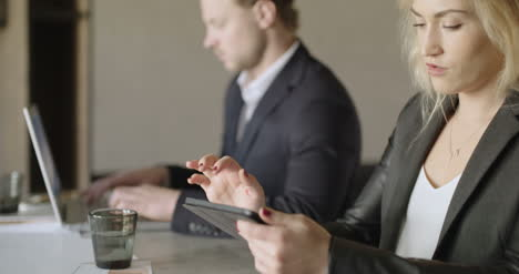 Businesswoman-Using-Digital-Tablet-At-Desk-In-The-Office
