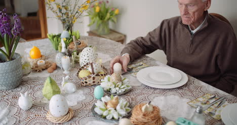 Elcerly-People-Care-Woman-Preparing-Table-For-Easter-1