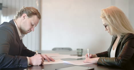 Business-People-Signing-Contract-