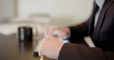 Man-Using-Tablet-In-Office-(Finance-Background)-1