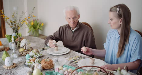 Happy-Easter-Grandfather-And-Granddaughter-Spending-Easter-Together-At-Home-1