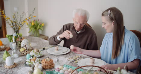 Happy-Easter-Grandfather-And-Granddaughter-Spending-Easter-Together-At-Home-4
