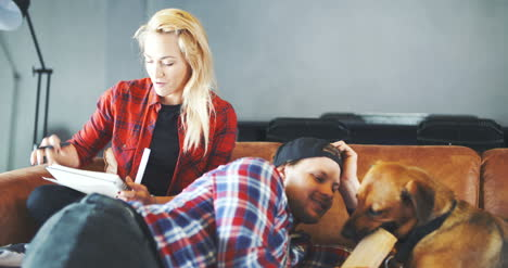 Young-Loving-Couple-With-Dog-At-Home