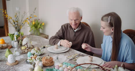 Happy-Easter-Grandfather-And-Granddaughter-Spending-Easter-Together-At-Home-5