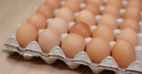 Eggs-Extruder-Full-Of-Fresh-Eggs-On-Black-Background
