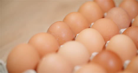 Eggs-Extruder-Full-Of-Fresh-Eggs-On-Black-Background-5