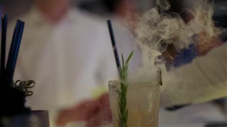 Bartender-Preparing-Dry-Ice-Drink-At-Club