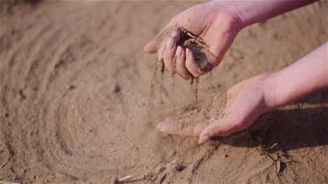 Farmer-Touching-Dirt-In-Hands-Pouring-Organic-Soil-3