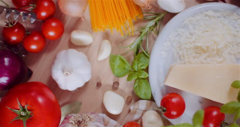 Fresh-Food-Ingredients-On-Wooden-Table-In-Kitchen