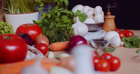 Close-Up-Of-Various-Vegetables-On-Table-Rotating-Fresh-Tomato-Carrot-Red-Onion-And-Garlic-2