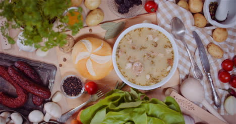 Soup-In-Bowl-Amidst-Various-Ingredients-Assorted-On-Wooden-Table-1