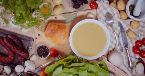 Soup-In-Bowl-Amidst-Various-Ingredients-Assorted-On-Wooden-Table-4