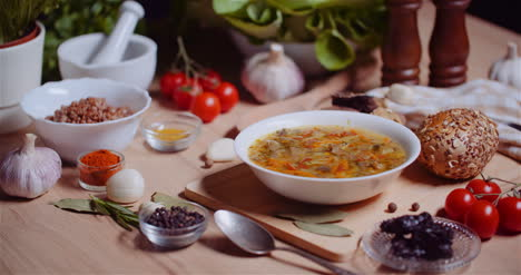 Soup-In-Bowl-Amidst-Various-Ingredients-Assorted-On-Wooden-Table-7