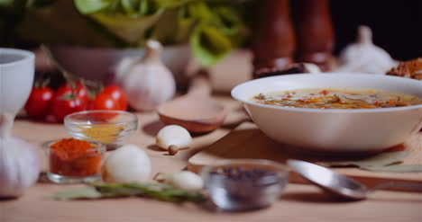 Soup-In-Bowl-Amidst-Various-Ingredients-Assorted-On-Wooden-Table-9