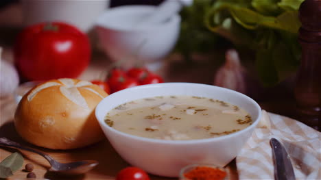 Soup-In-Bowl-Amidst-Various-Ingredients-Assorted-On-Wooden-Table-11