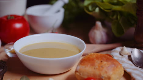 Soup-In-Bowl-Amidst-Various-Ingredients-Assorted-On-Wooden-Table-2