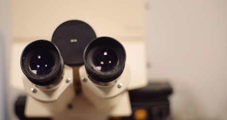 Close-Up-Panning-Shot-Of-Binocular-Optical-Microscope-In-Laboratory