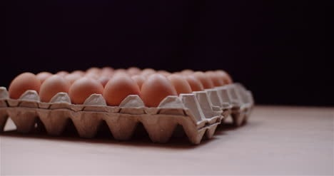 Eggs-Extruder-Full-Of-Fresh-Eggs-On-Black-Background-6