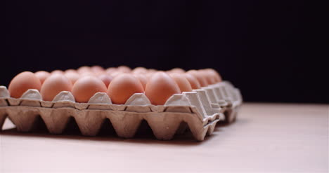 Eggs-Extruder-Full-Of-Fresh-Eggs-On-Black-Background-9