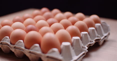 Eggs-Extruder-Full-Of-Fresh-Eggs-On-Black-Background-10