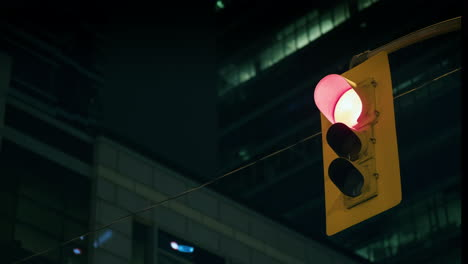 Traffic-Light-Against-Background-Of-Skyscrapers