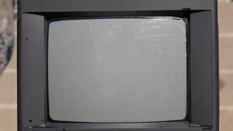 Water-Hits-Old-TV-Screen