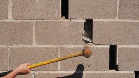 Smashing-Wall-With-A-Hammer
