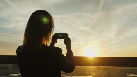 Woman-In-Business-Suit-Takes-Photo-Of-Sunset